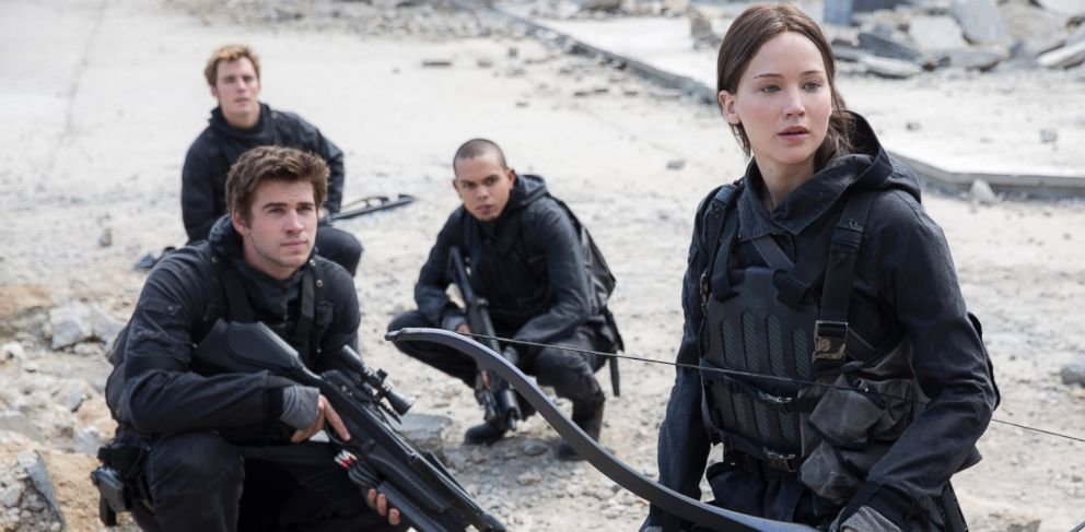 PHOTO: Gale Hawthorne (Liam Hemsworth, front left), Finnick Odair (Sam Claflin, back left), Messalla (Evan Ross, back right) and Katniss Everdeen (Jennifer Lawrence, front right) in The Hunger Games: Mockingjay - Part 2.