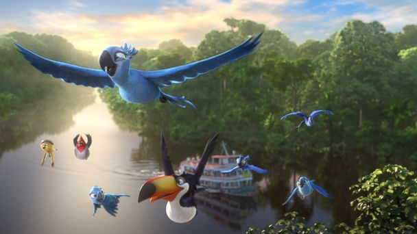 PHOTO: Blu, Jewel and their family fly above the Amazon River in a scene from Rio 2.