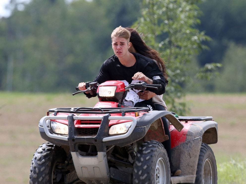 PHOTO: Justin Bieber and Selena Gomez are seen riding on an ATV in Stratford, Canada, Aug. 29, 2014.