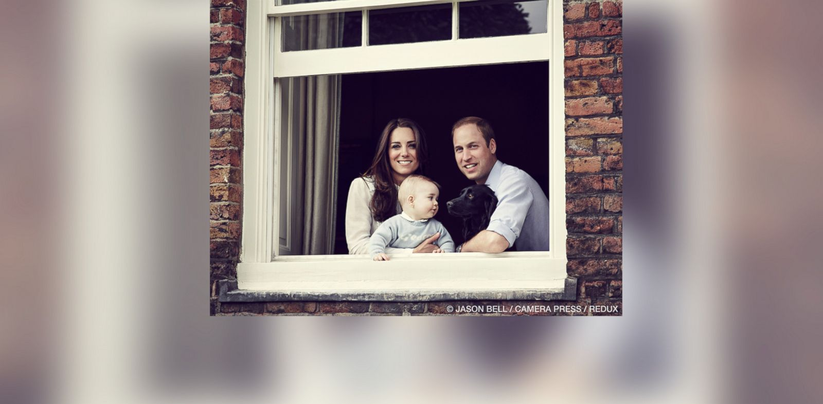 PHOTO: The Duke and Duchess of Cambridge with their son Prince George and dog Lupo photographed at Kensington Palace, London, March 2014.