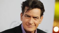 """'PHOTO: Cast member Charlie Sheen poses at the premiere of his new film """"Scary Movie 5"""" in Hollywood, Calif. on April 11, 2013.' from the web at 'http://a.abcnews.go.com/images/Entertainment/RT_CSheen_MEM_151116_16x9t_240.jpg'"""