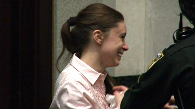 """PHOTO:Casey Anthony is pictured smiling upon hearing a """"not guilty"""" verdict, July 5, 2011."""