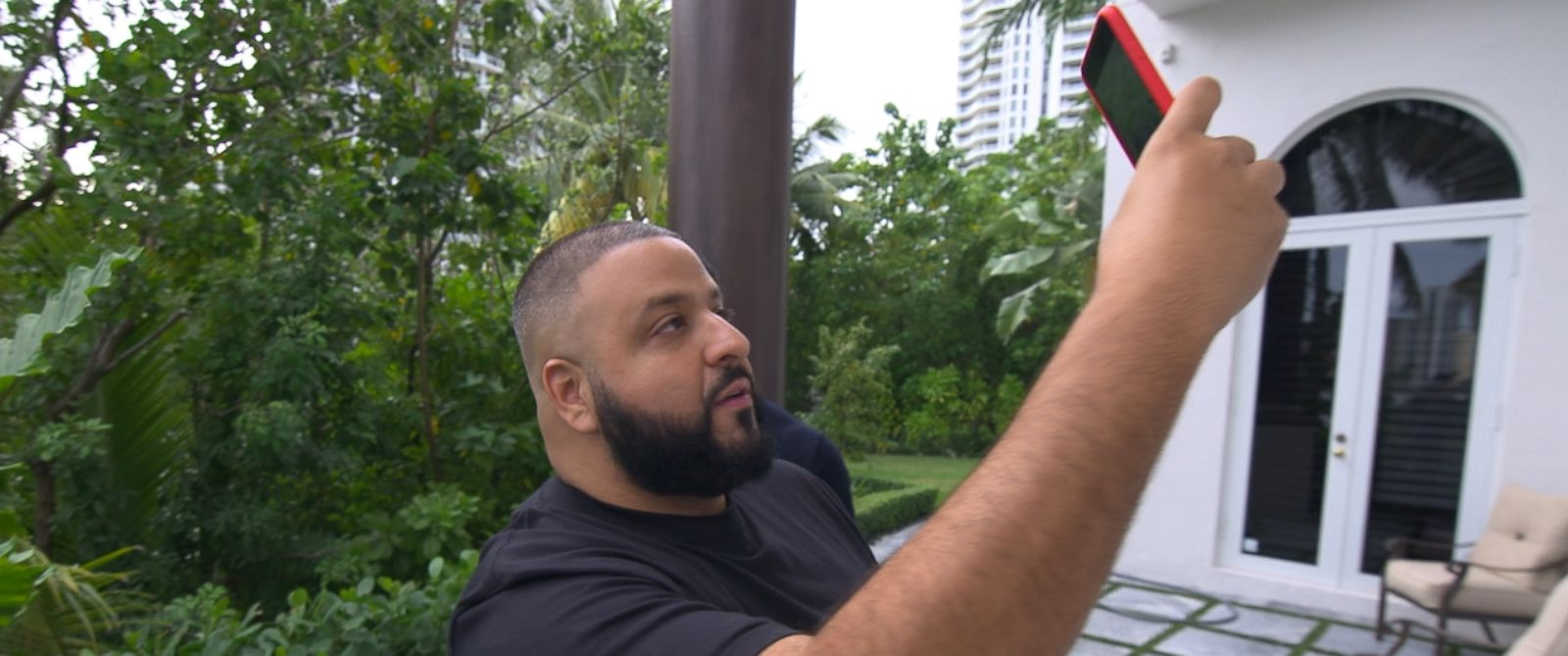 DJ Khaled, whose fame has exploded on Snapchat, is seen here in the backyard of his Miami mansion.