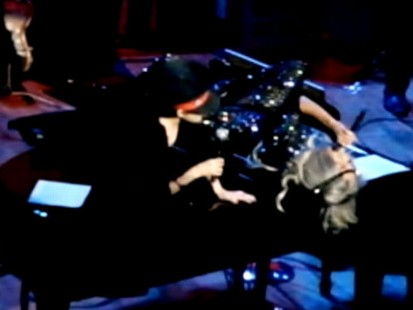 VIDEO: Lady Gaga joins Yoko Ono atop a piano during concert for John Lennons birthday.