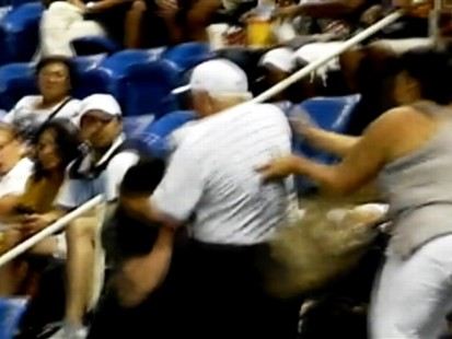 VIDEO: A trio of arguing tennis fans start a fight in the stands.