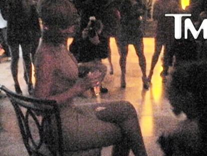 Video: Pop star Rihanna gets a lap dance from a female dwarf.