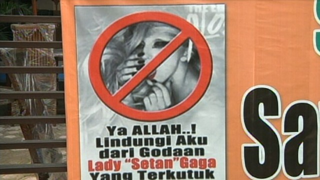 VIDEO: Lady Gagas show is pulled as the singer is called Satan by Muslim protesters.