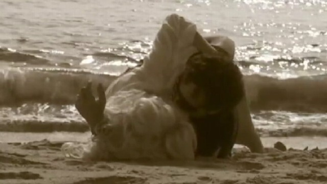 """VIDEO: Former """"Housewife"""" appears in beach scenes with boyfriend guitarist Neal Schon."""