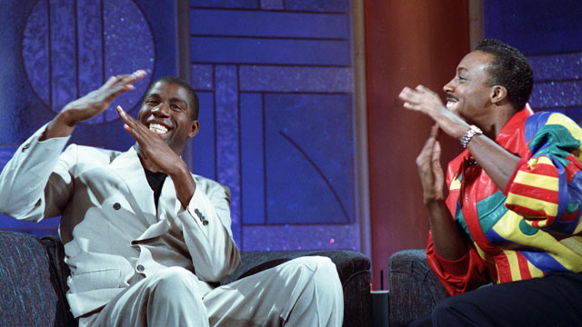"""PHOTO: Earvin """"Magic"""" Johnson, left, and host Arsenio Hall gesture for time during taping of the Arsenio Hall Show Nov. 9, 1991 in Los Angeles."""