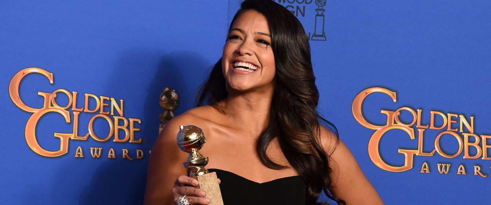 "PHOTO: Gina Rodriguez poses with the award for best actress in a television series - musical or comedy for ""Jane the Virgin"" at the Golden Globe Awards, Jan. 11, 2015, in Beverly Hills, Calif."