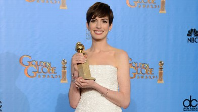 "PHOTO: Anne Hathaway poses with the award for best performance by an actress in a supporting role in a motion picture in ""Les Miserables"" backstage at the 70th Annual Golden Globe Awards, Jan. 13, 2013, in Beverly Hills, Calif."