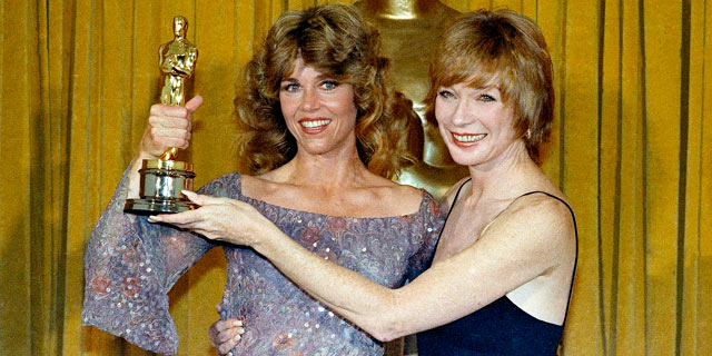 """PHOTO: Jane Fonda, the Oscar Winner for Best Actress in """"Coming Home,"""" with presenter Shirley Maclaine in this April 9, 1979 file photo at the 51st Academy Awards in Los Angeles."""