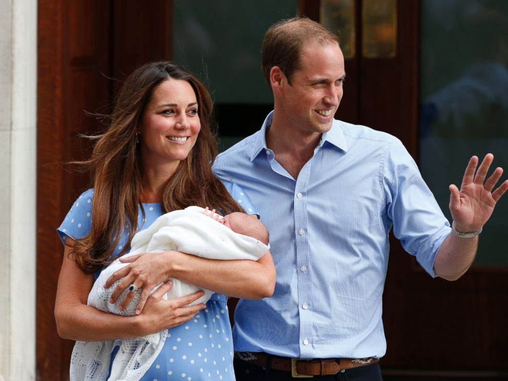 PHOTO: Britains Prince William and Kate, Duchess of Cambridge hold the Prince of Cambridge, July 23, 2013, as they pose for photographers outside St. Marys Hospital exclusive Lindo Wing in London where the Duchess gave birth.