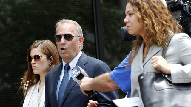 PHOTO: Actor Kevin Costner, center, leaves Federal Court for a lunch break in New Orleans, June 4, 2012.