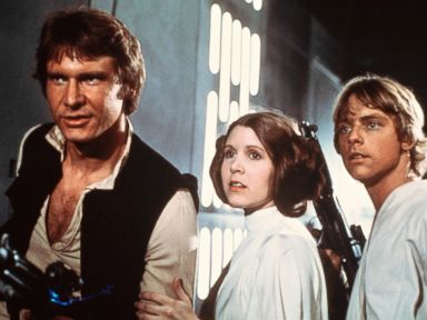 PHOTO: Harrison Ford, as Han Solo, Carrie Fisher, as Princess Leia, and Mark Hamill, as Luke Skywalker in a scene from the 1977 movie, Star Wars IV: A New Hope.
