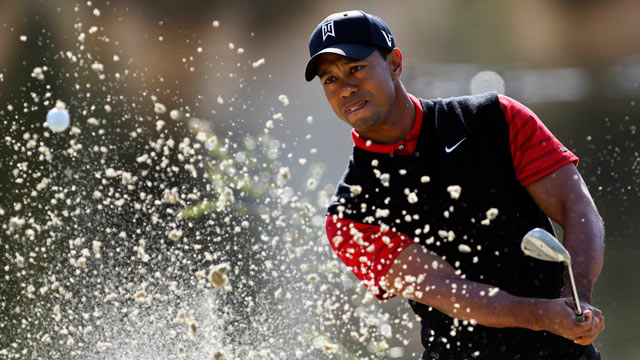 PHOTO: Tiger Woods on the third hole during the final round of the Chevron World Challenge golf tournament.