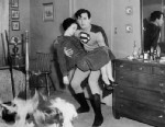 "PHOTO: Superman, Kirk Alyn, arrives in time to save housewife, Jean West, from a fire in an apartment building, in ""Superman."""