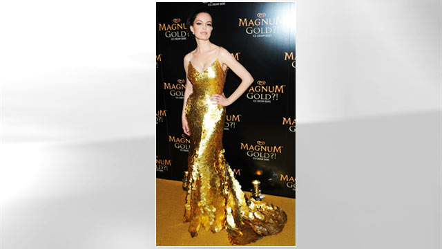 "PHOTO: Actress Caroline Correa (wearing Zac Posen's one of a kind 24k gold dress) attends the screening of ""As Good As Gold"" during the 2013 Tribeca Film Festival at Gotham Hall, April 18, 2013 in New York City."