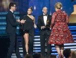 "PHOTO: Singers Jennifer Lopez, Pitbull present Adele the Best Pop Solo Performance for ""Set Fire to the Rain (Live)"" onstage while Vitalii Seduik tries to crash the stage at the 55th Annual Grammy Awards at Staples Center on Feb. 10, 2013 in Los Angeles."