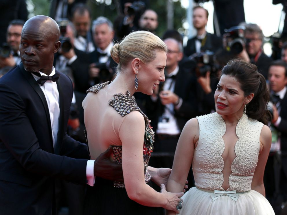 PHOTO: America Ferrera reacts after a man attempted to climb under her dress on the red carpet at the How To Train Your Dragon 2 premiere during the Cannes Film Festival on May 16, 2014 in Cannes, France.