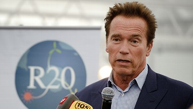 PHOTO: Former Governor of California, Arnold Schwarzenegger, delivers a speech on March 8, 2012 in Geneva.