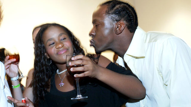 "PHOTO: Bobbi Kristina and her dad Bobby Brown play around at the premiere of the new show ""Being Bobby Brown"" on June 27, 2005 in Atlanta, Georgia."