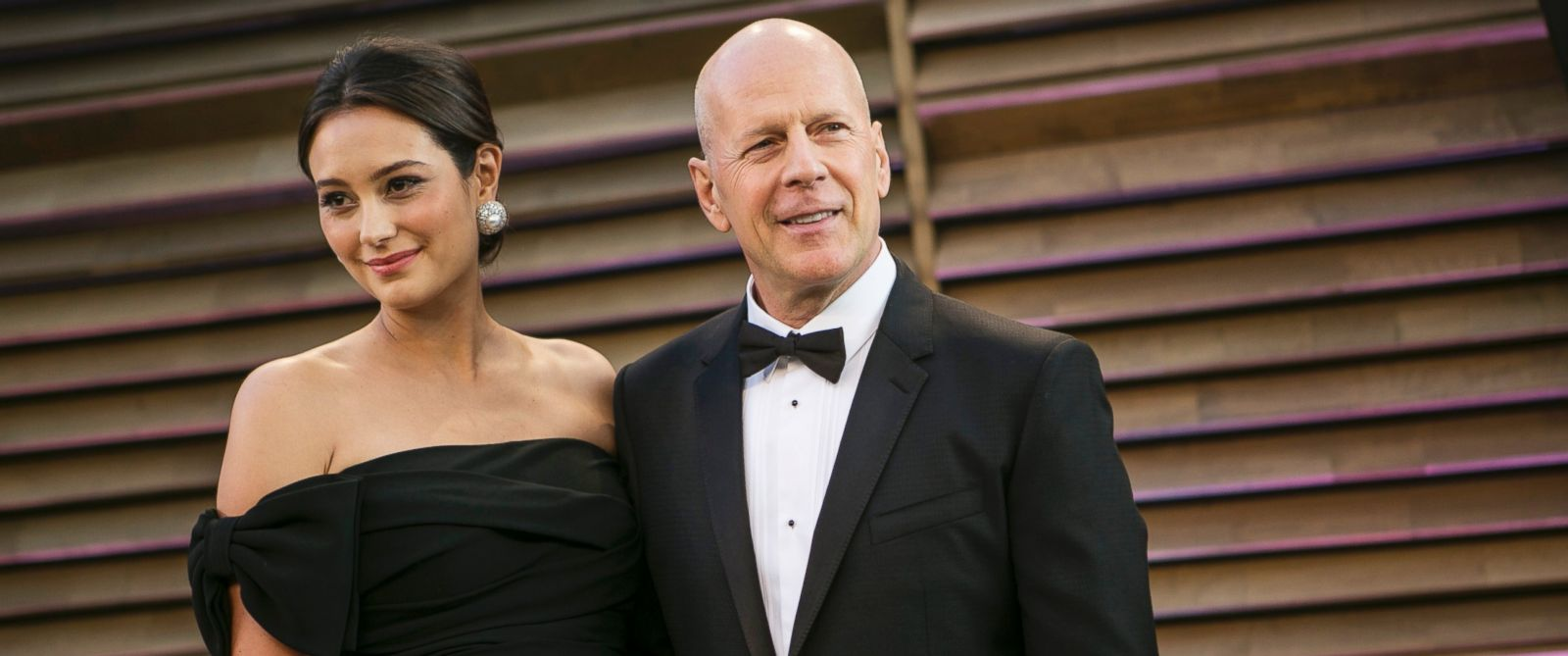 PHOTO: Bruce Willis and his wife Emma Heming arrive at the 2014 Vanity Fair Oscar Party on March 2, 2014 in West Hollywood, California.