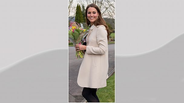 PHOTO: Catherine, Duchess of Cambridge carries flowers as she visits the offices of Child Bereavement UK on March 19, 2013 in Saunderton, Buckinghamshire.