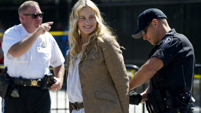 PHOTO: Police officers arrest US actress Daryl Hannah during a protest against the construction of the Keystone XL pipeline, outside the White House in Washington, DC, Aug. 30, 2011.