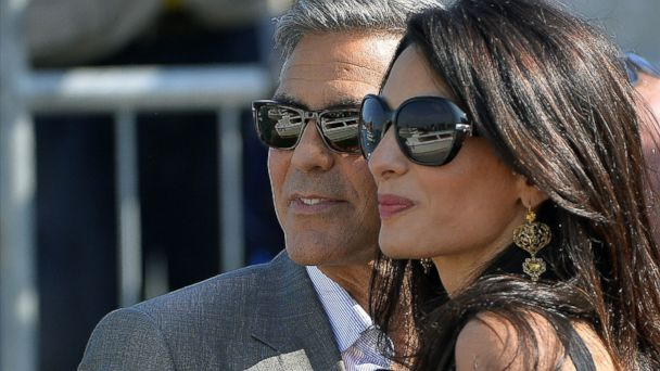 PHOTO: George Clooney ( L) and Amal Alamuddin, his Lebanon-born British fiancee, on a taxiboat in Venice upon their arrival on Sept. 26, 2014.