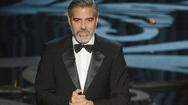 PHOTO: Actor/director George Clooney speaks onstage at the 85th Annual Academy Awards, Feb. 24, 2013 in Hollywood.