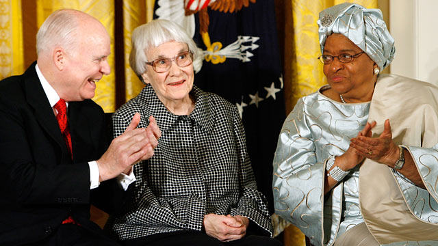 "PHOTO: CEO of C-SPAN Brian Lamb, left, and Liberia President Ellen Johnson Sirleaf, right, applaud Pulitzer Prize winner ""To Kill A Mockingbird"" author Harper Lee."
