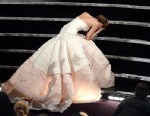 "PHOTO: Actress Jennifer Lawrence falls after winning the Best Actress award for ""Silver Linings Playbook"" during the Oscars held at the Dolby Theatre on Feb. 24, 2013 in Hollywood."
