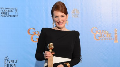 "PHOTO: Julianne Moore poses with her Best performance by an actress in a mini-series or motion picture made for television award for ""Game Change"" in the press room at the Golden Globes awards ceremony in Beverly Hills, January 13, 2013."
