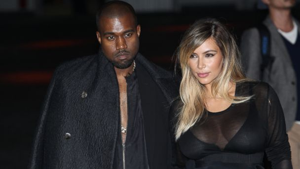 PHOTO: Kanye West and Kim Kardashian attend the Givenchy show as part of the Paris Fashion Week Womenswear Spring/Summer 2014 on September 29, 2013 in Paris, France.