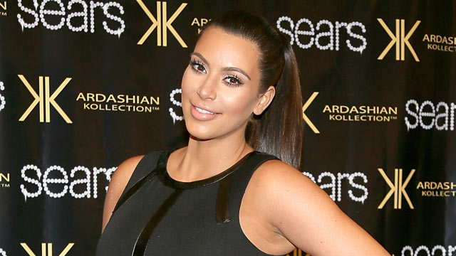 "PHOTO: Kim Kardashian poses on the red carpet at Sears to promote the ""Spring 2013 Kardashian Kollection"" on May 4, 2013 in Houston, Texas."