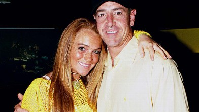 PHOTO: Lindsay Lohan and her father Michael Lohan pose at Billboard Live in Miami Beach on June 26, 2002.