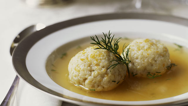 PHOTO: Vegetable soup with matzo balls and dill oil.