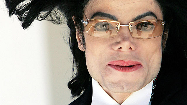 PHOTO: Pop Singer Michael Jacksons hair flies in the wind as he departs the Santa Barbara County courthouse, April 29, 2005, in Santa Maria, Calif.