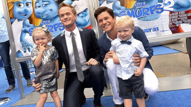 "PHOTO: Neil Patrick Harris, second from left, and partner David Burtka are joined by their children, Harper Grace Burtka-Harris, left, and Gideon Scott Burtka-Harris, as they attend the Los Angeles premiere of the film ""The Smurfs 2."""