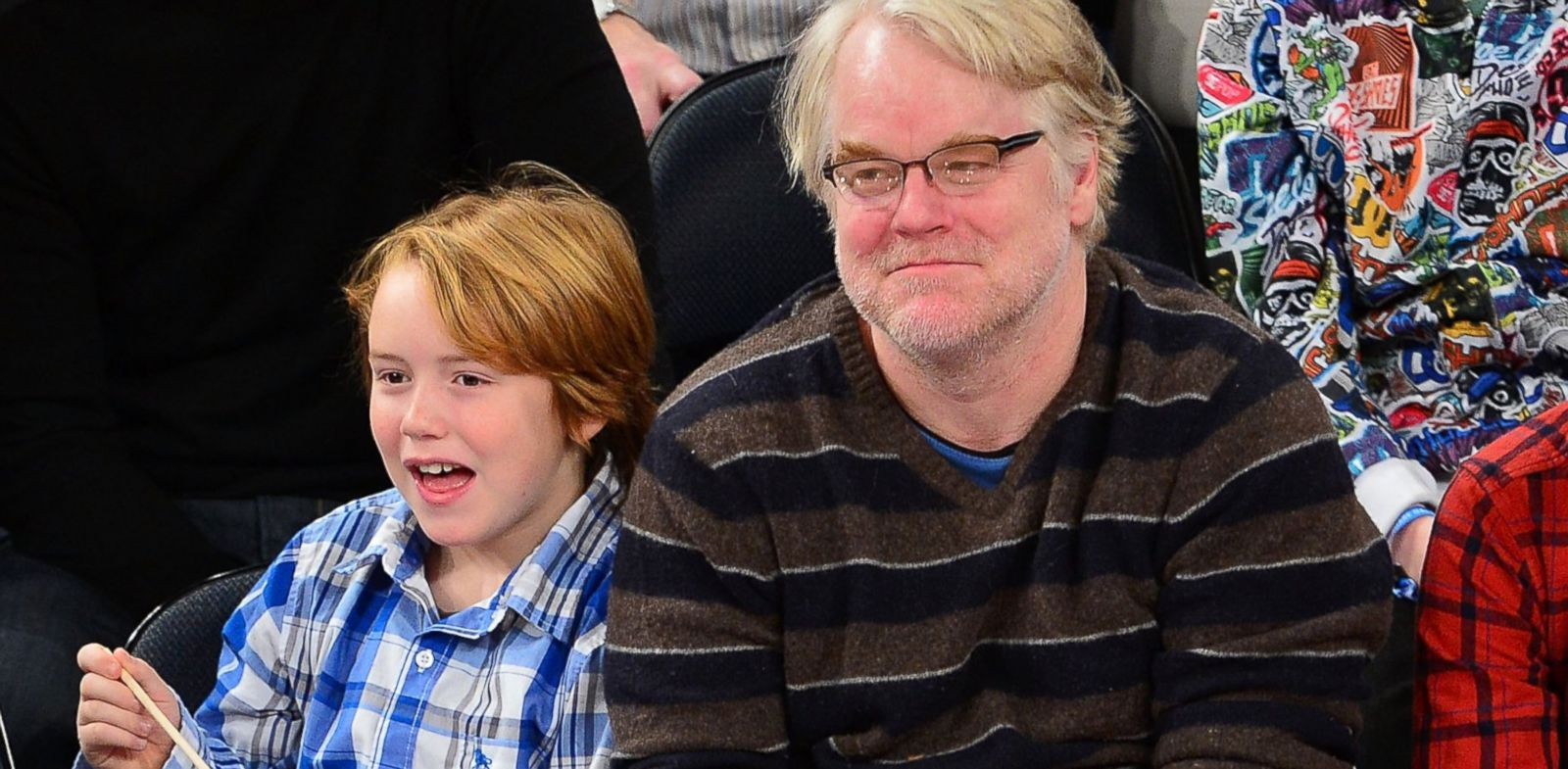PHOTO: Philip Seymour Hoffman and son Cooper Alexander Hoffman attend the Detroit Pistons vs New York Knicks game at Madison Square Garden, Nov. 25, 2012 in New York City.