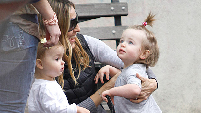 PHOTO: Sarah Jessica Parker is seen with her twin daughters Marion (R) and Tabitha Broderick on the streets of Manhattan, October 23, 2010.
