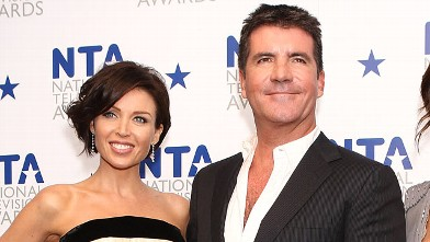 PHOTO: Simon Cowell is shown with Dannii Minogue at The O2 Arena, Jan. 20, 2010 in London, England.