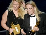 """PHOTO: Sound editors Karen Baker Landers and Per Hallberg accept the Best Sound Editing award for Skyfall"""" and  onstage during the Oscars held at the Dolby Theatre on February 24, 2013 in Hollywood."""