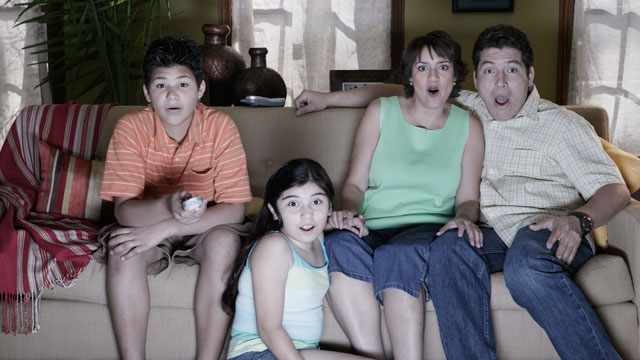 PHOTO: Watching television with family can lead to awkward situations.