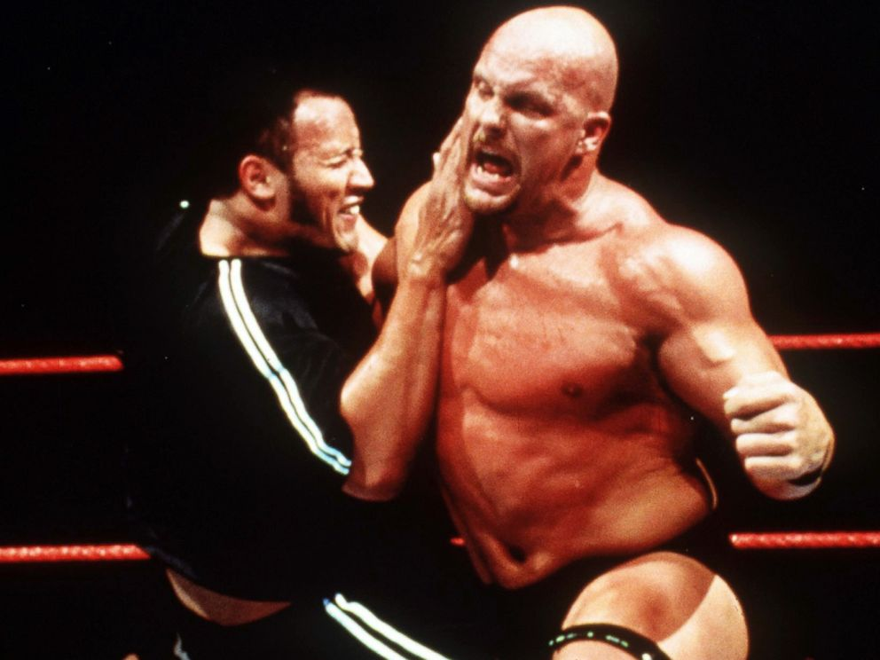 PHOTO: Dwayne The Rock Johnson and Stone Cold Steve Austin wrestle in WWF Smackdown.