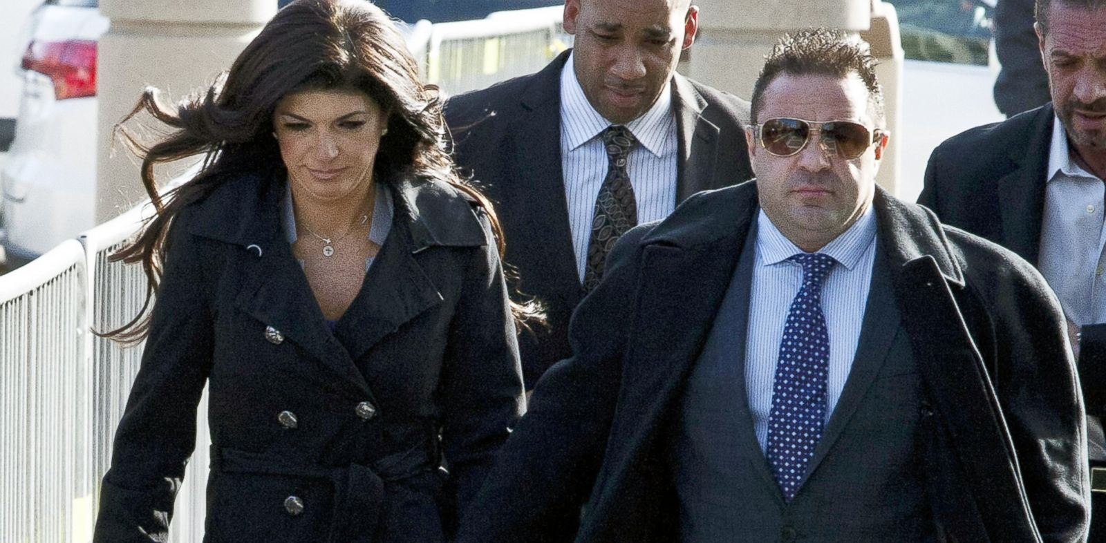 """PHOTO: Giuseppe """"Joe"""" Giudice and his wife, Teresa Giudice walk out of the Martin Luther King, Jr. Courthouse after a court appearance, Nov. 20, 2013, in Newark, N.J."""