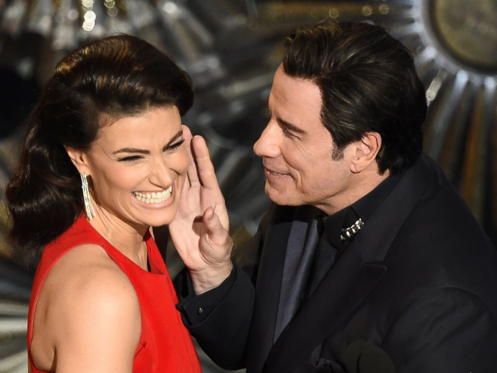 PHOTO: John Travolta (R) and Idina Menzel present an award on stage at the 87th Academy Awards, Feb. 22, 2015 in Hollywood, California.