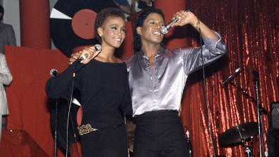 PHOTO: American singer Whitney Houston performs with Jermaine Jackson at Limelight in New York City, July 1984.