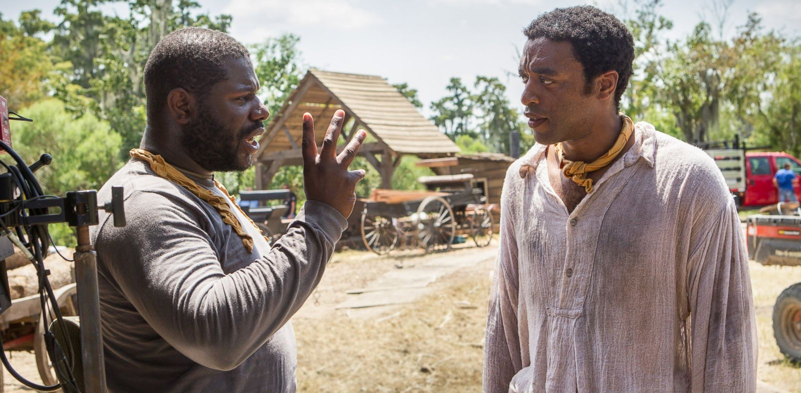 "PHOTO: In this production still, director Steve McQueen, left, and actor Chiwetel Ejiofor, right, are pictured on the set of ""12 Years a Slave."""